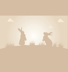 silhouette of easter bunny at sunset vector image