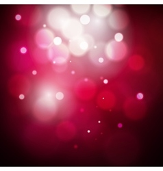 Abstract red and pink circular bokeh background of vector image vector image