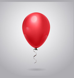 Shiny red balloon with ribbon on grey background vector