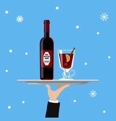 bottle of mulled wine and glass on tray on blue vector image