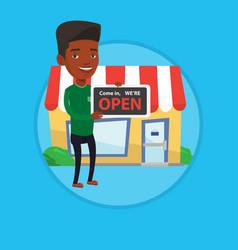 shop owner holding open signboard vector image