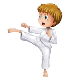 A brave boy doing his karate moves vector