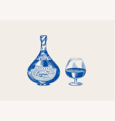 cognac bottle and glass goblet engraved hand vector image