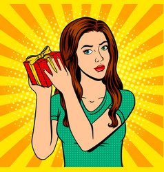 girl with gift box pop art vector image