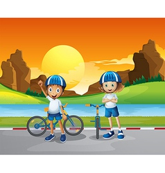 Two kids with their bikes standing at the road vector image vector image