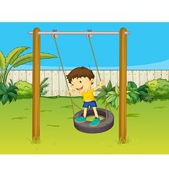 A boy swings on a wheel vector image vector image