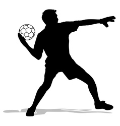 silhouettes of soccer players with the ball vector image