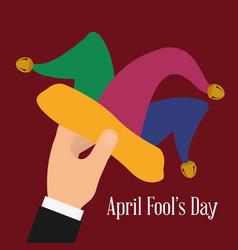 april fools day hand holding hat joker vector image