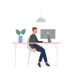 young man sitting at table and working vector image