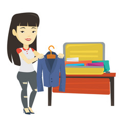 Young woman packing suitcase vector