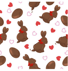 Seamless pattern with chocolate bunnies eggs vector