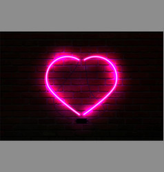 pink glowing neon heart on brick wall background vector image