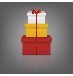Stack of three realistic gift boxes with red vector