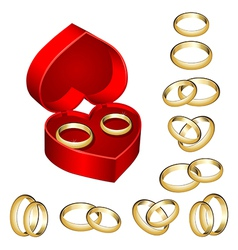 set of gold wedding rings with heart-shaped box vector image