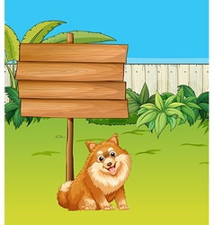 Dog and wooden sign in the garden vector image vector image