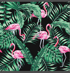 green tropical leaves and pink flamingo seamless vector image