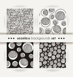 set of seamless doodle prints of moons or ing-yang vector image