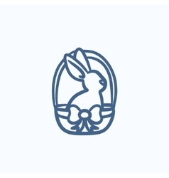 Easter bunny sitting in basket sketch icon vector image vector image