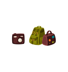 travel bag backpack and compact digital camera vector image