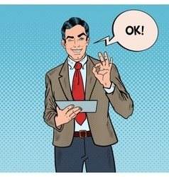 Pop Art Businessman with Tablet Gesturing OK vector