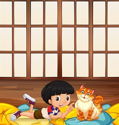 Boy playing with kitten in a room vector