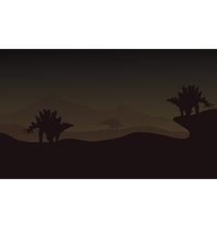 At night Stegosaurus in hills scnery vector