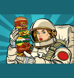 hungry woman astronaut with giant burger vector image