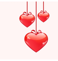 Red glossy hearts hanging with ribbon bows vector image