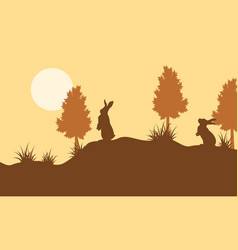 Silhouette of bunny and tree landscape vector
