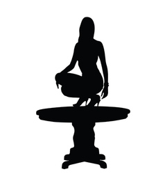 woman on table silhouette vector image