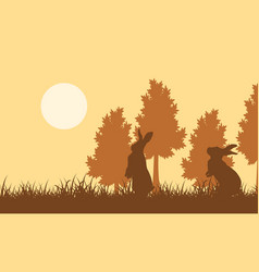 Silhouette of easter bunny on field landscape vector
