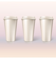 Disposable cups for coffee closeup vector image