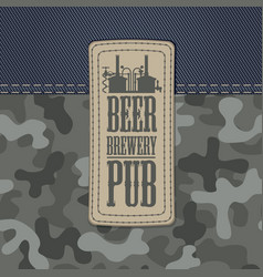 Leather beer label on a camo and denim background vector