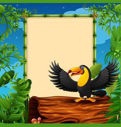 cartoon toucan presenting on hollow log near the e vector image