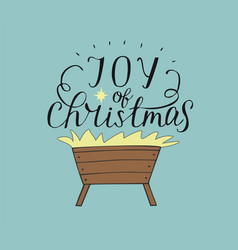 Hand lettering joy of christmas with manger and vector