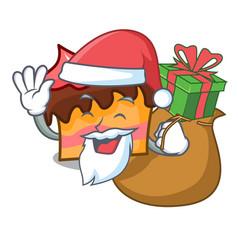 Santa with gift sponge cake mascot cartoon vector