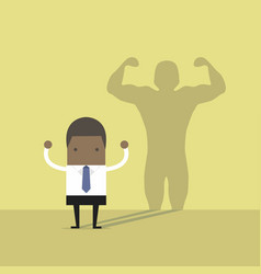 african businessman casting strong man shadow vector image