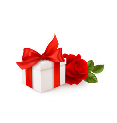 Realistic white gift box with red bow ribbon vector