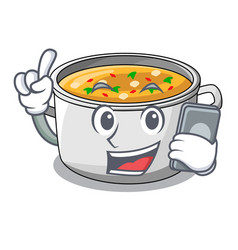 With phone vegetable soup with pasta in pot vector