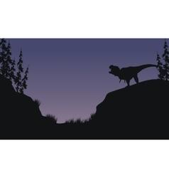 Tyranosaurus in hills scnery silhouette vector