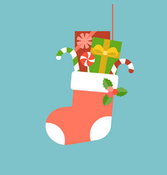 christmas sock with present boxes and candy cane vector image