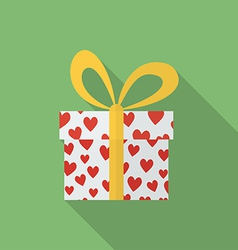 Gift box with hearts and a bow Flat style icon vector image vector image