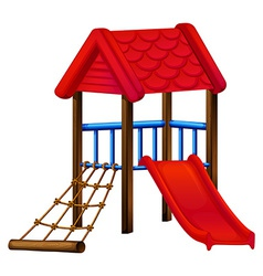A toy house at the park with a slide vector image