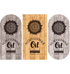 three labels for sunflower oil on wooden backdrop vector image