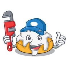 Plumber cinnamon roll mascot cartoon vector