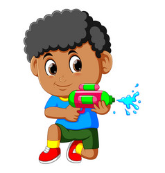 boy playing with water gun vector image
