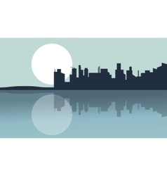 Silhouette of city and reflection with full moon vector image vector image
