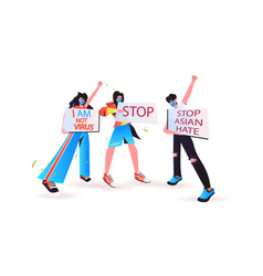 stop asian hate activists in masks holding banners vector image