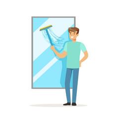 young smiling man washing window house husband vector image vector image