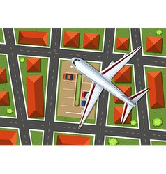 Aerial view of airplane flying over neighborhood vector image